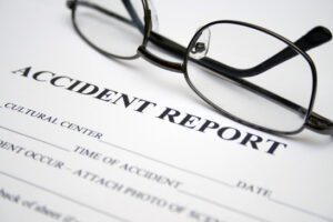 Accident Report with pair of glasses on top